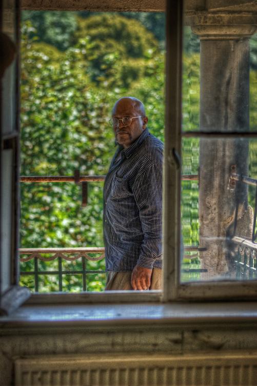 Male standing in window