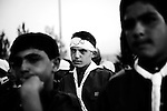"8/30/2008 Ryak, Lebanon.Young members of Hezbollah's Mahdi Scouts watch as dignitaries, including Nazil Fatih, an official in charge of the entire Mahdi Scout program, at ""Scout City"" in Lebanon's Beka'a valley, make speeches praising the youth organization and the ""Resistance"" (Hezbollah), at a Mahdi Scout Graduation ceremony...The Imam al-Mahdi Scouts are one of Hezbollah's many social programs in Lebanon. Originally founded in 1985, the youth-centered scout program includes both boys and girls, and counts at least 40,000 members in it's ranks, divided into the classifications of Cub, Scout, and Ranger. Although the Mahdi Scouts are part of the Lebanese Scouting Federation, and thereby The World Organization of the Scout Movement, it is believed by some intelligence services that the Mahdi Scouts serve as a recruiting tool for Hezbollah's armed wing, filtering out potential fighters based on their discipline and religious devotion, as well as initiating the male Scouts and Rangers into basic military training. In contrast to these accusations, much of the Mahdi Scouts visible activities center around intense religious education, outdoor activities, arts and crafts, performances, as well as community based social assistance and service similar to those practiced by scout movements around the world..."