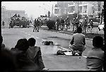 Demonstrators in the funeral cortege of Karan Nejayatollahi, the 27-year-old professor killed during a sit-in strike the day before, face off against the army. Tehran, December 27, 1978