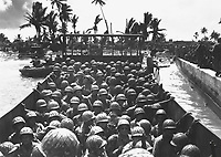 &quot;Paradise Lost&quot; by Japs at Kwajalein.  Palm-studded Carlos Island, a South Pacific paradise in the Marshalls, falls to American invasion forces driving ashore in Coast Guard-manned landing craft.  February 1944.  Morris A. Lucia.  (Coast Guard)<br /> Exact Date Shot Unknown<br /> NARA FILE #:  026-G-3289<br /> WAR &amp; CONFLICT BOOK #:  1166