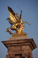 """Gilt-bronze statue of """"Fame"""" supported on massives 17 meter socles, Pont Alexandre III, 1896-1900 for World Expo 1900 to commemorate the French-Russian Alliance of 1892, by the architects J. Cassine-Bernard and G. Cousin and engineers A. Alby and J. Resal, 8th arrondissement, Paris, France Picture by Manuel Cohen"""