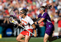 Caitlyn McFadden (3) of Maryland moves past Brooke Matthews (18) of Northwestern during the NCAA Championship held in Johnny Unitas Stadium at Towson University in Towson, MD.  Maryland defeated Northwestern, 13-11, to win the title.