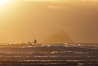 Surfer at St. Finian's Bay near Skellig Michael, County Kerry, Ireland