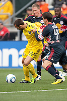 Mar 26, 2011; Columbus, OH, USA; Columbus Crew midfielder Dejan Rusmir (22) fights around New York Red Bulls defender Carlos Mendes (44) during their match at Columbus Crew Stadium.