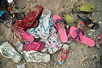 20141102piscinaoramos0119 - <br /> Havaiana flip flops are left in a pile on the beach while their owners play in the piscinao.
