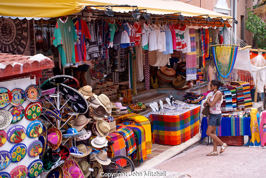 Young woman entering a Mexican handicrafts store, in Playa del Carmen, Riviera Maya, Quintana Roo, Mexico.