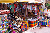 Young woman entering a Mexican handicrafts store, in Playa del Carmen, Riviera Maya, Quintana Roo, Mexico.