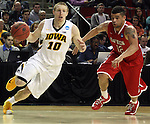 Iowa's Mike Gesell (10) goes to the basket while being guarded by Davidson's Jack Gibbs (12)  during 2015 NCAA Division I Men's Basketball Championship March 20, 2015 at the Key Arena in Seattle, Washington.  Iowa beat Davidson 83-52.   ©2015. Jim Bryant Photo. ALL RIGHTS RESERVED.