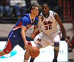 SMU's Jeremiah Samarrippas (12) drives against Mississippi's Jarvis Summers (32)at the C.M. &quot;Tad&quot; Smith Coliseum in Oxford, Miss. on Tuesday, January 3, 2012. (AP Photo/Oxford Eagle, Bruce Newman)