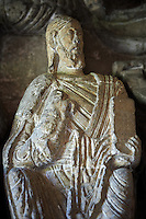 "Early Anglo Saxon sulpture of the Christ now part of the south porch of Malmesbury Abbey, Wiltshire, England. The apostles, apart from Peter who holds a crude key, have no distinguishing feature to allow identification. Some are holding books, none have halos and some hold their heads at awkward angles. These three styles are typical of Anglo Saxon art. The two panels are 10 ft long and 4ft 6"" high are date from the original Ango Saxon church of 705. They were probablbly built into the proch during the Norman rebuilding. The style of these sculptures is of the Roman Byzantine style and were probably sculpted by masions from Gaul.  Malmesbury Abbey, Wiltshire, England"