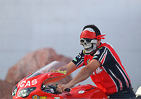 Oct 29, 2016; Las Vegas, NV, USA; NHRA pro stock motorcycle rider Hector Arana Jr wears a halloween mask during qualifying for the Toyota Nationals at The Strip at Las Vegas Motor Speedway. Mandatory Credit: Mark J. Rebilas-USA TODAY Sports