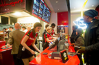 """Hundreds of burger lovers descend on the new Steak 'n Shake Signature restaurant in New York on its grand opening day, Thursday, January 12, 2012. The popular midwest chain opened its first New York outpost with a new concept for the restaurant, a smaller footprint and counter-only service, hence their """"Signature"""" branding. Founded in 1934 the company has nearly 500 restaurants with this one in New York being next to the Ed Sullivan Theatre where the Late Show with David Letterman Show is taped. © Frances M. Roberts)"""
