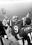 McMahon_handsup_411 R-16..Holiday Bowl vs Washington. 9 Jim McMahon. 16 Blaine Fowler...December 15-19, 1980..Box: 6371, 6375, 6376..Photography by: Mark Philbrick/BYU..Copyright BYU PHOTO 2008.All Rights Reserved.801-422-7322.photo@byu.edu..