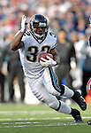 26 November 2006: Jacksonville Jaguars running back Maurice Jones-Drew (32) rushes for a touchdown against the Buffalo Bills at Ralph Wilson Stadium in Orchard Park, NY. The Bills defeated the Jaguars 27-24. Mandatory Photo Credit: Ed Wolfstein Photo<br />
