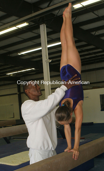 NEW MILFORD, CT-10August 2006-081006TK03- Serena Shaw, 11, of Litchfield working on her gymnastic routines assisted by her coach Russell Wallace, at the Elite Gymnastic Center in New Milford. Tom Kabelka Republican-American (Serena Shaw, Russell Wallace, gymnastic routines)