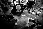 From left, Peter Davi, Tom DiMaggio, Vincenzo Costa, and Joseph DiRocco play the Italian card game briscola in Cafe Noir in downtown Monterey, CA on Monday, January 29, 2007.