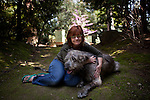 Kathy Bowler poses for a portrait with her dog Brogan at her Sacramento, California home, March 17, 2013. Brogan, a six-year-old Irish wolfhound. is currently undergoing treatment for osteosarcoma, a fatal bone cancer.
