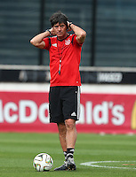Germany coach Joachim Low looks on during training ahead of tomorrow's World Cup Final