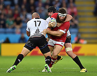 Hubert Buydens of Canada is double-tackled. Rugby World Cup Pool D match between Canada and Romania on October 6, 2015 at Leicester City Stadium in Leicester, England. Photo by: Patrick Khachfe / Onside Images