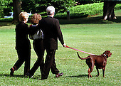 """Buddy"" the dog leads the First Family to Marine 1 on the South Lawn of the White House on August 19, 1999.  The Clintons are to vacation for 2 weeks beginning in Martha's Vineyard..Credit: Ron Sachs / CNP"