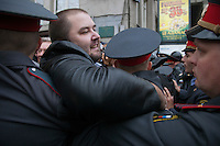 Moscow, Russia, 31/08/2010..Police and demonstrators struggle as police break up an opposition protest in central Moscow and arrest around 70 people. Opposition activists hold regular demonstrations on the 31st day of the month, protesting against restrictions on the freedom of assembly, which is protected by article number 31 of the Russian constitution.