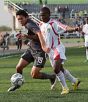Victor Chavez battles against Francis Mulimbika. US Men's National Team Under 17 defeated Malawi 1-0 in the second game of the FIFA 2009 Under-17 World Cup at Sani Abacha Stadium in Kano, Nigeria on October 29, 2009.