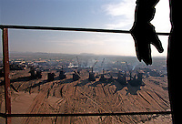 A worker looks out over the Gaddani ship-breaking yard.