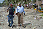 John Nduna (right), the general secretary of the ACT Alliance, talks with Edward Santos, a relief official for the National Council of Churches in the Philippines, as they walk along the ravaged seashore in Bacubac, a neighborhood in Basey in the Philippines province of Samar that was hit hard by Typhoon Haiyan in November 2013. The storm was known locally as Yolanda. NCCP and other members of the ACT Alliance have been providing a variety of forms of assistance to survivors here, and Nduna and other ACT Alliance leaders spent several days in affected communities learning first hand about the network's emergency response and long-term plans for recovery and rehabilitation.