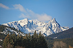 Snow covered Trapper Peak under a clear blue sky in the Bitterroot Mountains
