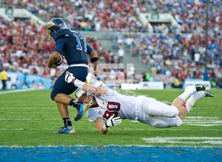 PASADENA, CA - November 24, 2012:  Stanford defensive end Josh Mauro (90) makes a sack during the Stanford Cardinal vs the UCLA Bruins at the Rose Bowl in Pasadena, CA. Final score Stanford Cardinal 34, UCLA Bruins 17.