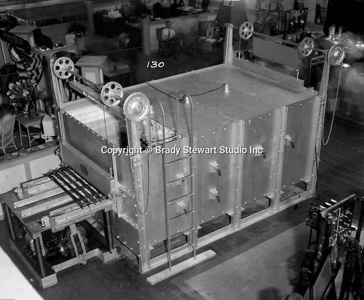 Pittsburgh PA:  View of Swindell Dressler Heat Treating Furnace at the Hunt Armory trade show - 1932.  Swindell Dressler International Company was based in Pittsburgh, Pennsylvania. The company was founded by Phillip Dressler in 1915 as American Dressler Tunnel Kilns, Inc.  In 1930, American Dressler Tunnel Kilns, Inc. merged with William Swindell and Brothers to form Swindell-Dressler Corporation. The Swindell brothers designed, built, and repaired metallurgical furnaces for the steel and aluminum industries. The new company offered extensive heat-treating capabilities to heavy industry worldwide.