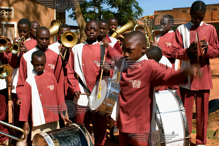11-year-old Ronald conducts the 'M-LISADA' street-kids band. The kids play euphoniums, trumpets, tubas, drums and trombones.