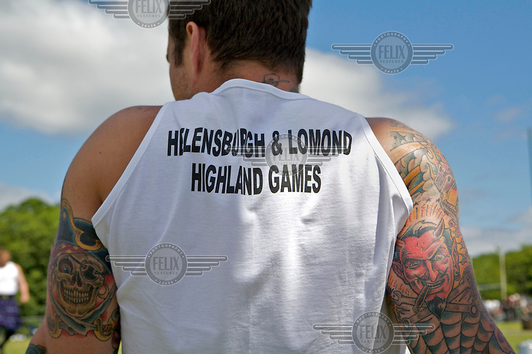 A competitor with tattoos at the Helensburgh and Lomond Highland Games in Argyll.