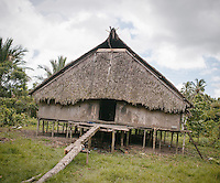 Uma, a traditional Mentawai house, of Aman Lau Lau in Buttui. The Mentawai are the tribes living traditionally in the island of Siberut, Indonesia. Here, where the changes came slow, some of the people are still living like their ancestors did centuries ago. They s till practice ancient religion called Arat Sabulungan, which believe that everything in the forest has a spirit.