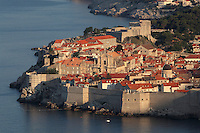 The medieval walled city with its defensive walls and 11th century Lovrijenac Fortress, Dubrovnik, Croatia. The city developed as an important port in the 15th and 16th centuries and has had a multicultural history, allied to the Romans, Ostrogoths, Byzantines, Ancona, Hungary and the Ottomans. In 1979 the city was listed as a UNESCO World Heritage Site. Picture by Manuel Cohen