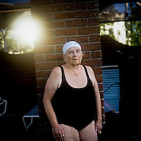 A portrait of Mikki Revenaugh who is a member of the Aquadettes at Laguna Woods, California. The Aquadettes are a group of women ageing from their early 60s upwards who meet to practice synchronised swimming. Every year, they practice together, they make costumes together, they swim together, and at the end, they perform together.