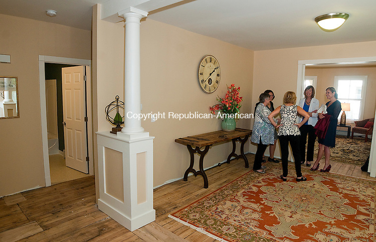 WATERBURY, CT--050715JS09- Paula Van Ness of the Connecticut Community Foundation; Maria Falvo of the American Savings Foundation; Kathy Luria with the Harold Webster Smith Foundation; Kristen Jacoby with the United Way and community leader Cathy Smith, chat inside the living room Thuesday as homes were opened up for viewing at Gaffney Place in Waterbury. The homes were rehabilitated as part of a project aimed at attracting new homeowners to the downtown district. <br /> Jim Shannon Republican-American