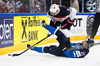 American Jacob Trouba (L) and Finland's Sebastian Aho fight for the puck during the Ice Hockey World Championship quarter-final match between the US and Final in the Lanxess Arena in Cologne, Germany, 18 May 2017. Photo: Marius Becker/dpa /MediaPunch ***FOR USA ONLY***