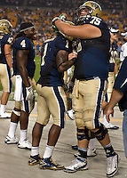 Ray Graham (1) being congratulated by Ryan Turnley (75).. The Pittsburgh Panthers beat the Buffalo Bulls 35-16 at Heinz field in Pittsburgh, Pennsylvania on September 3, 2011
