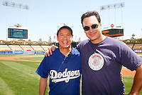 4 May 2011: Celebrity guests radio host Rick Dees and TV star Patrick Warburton on the field together before the Cubs defeated the Dodgers 5-1 during a Major League Baseball game at Dodger Stadium in Los Angeles, California.  Dodgers players are wearing Brooklyn Dodger 1940's throwback jersey uniforms and the Chicago Cubs are also wearing throwback retro jersey uniforms. **Editorial Use Only**
