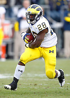 WEST LAFAYETTE, IN - OCTOBER 06: Running back Fitzgerald Toussaint #28 of the Michigan Wolverines runs the ball against the Purdue Boilermakers at Ross-Ade Stadium on October 6, 2012 in West Lafayette, Indiana. (Photo by Michael Hickey/Getty Images) *** Local Caption *** Fitzgerald Toussaint