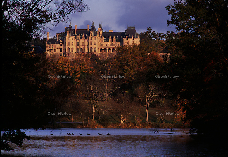 Biltmore Estate reflected in lagoon.<br /> In the late 1800s, George W. Vanderbilt sought the advice of Frederick Law Olmsted, the country's preeminent landscape designer, to help him with an appropriate design to complement the French Renaissance-style ch&acirc;teau he was building in the Blue Ridge Mountains. The resulting Biltmore Estate is a masterpiece and enjoyed by nearly one million visitors each year.
