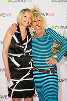 Carole Hochman, and Betsey Johnson smile on stage at the CURVE and CFDA Party For A Cause event during the CURVENY Lingerie & Swim show, at the Jacob Javits Convention Center, August 2, 2010.