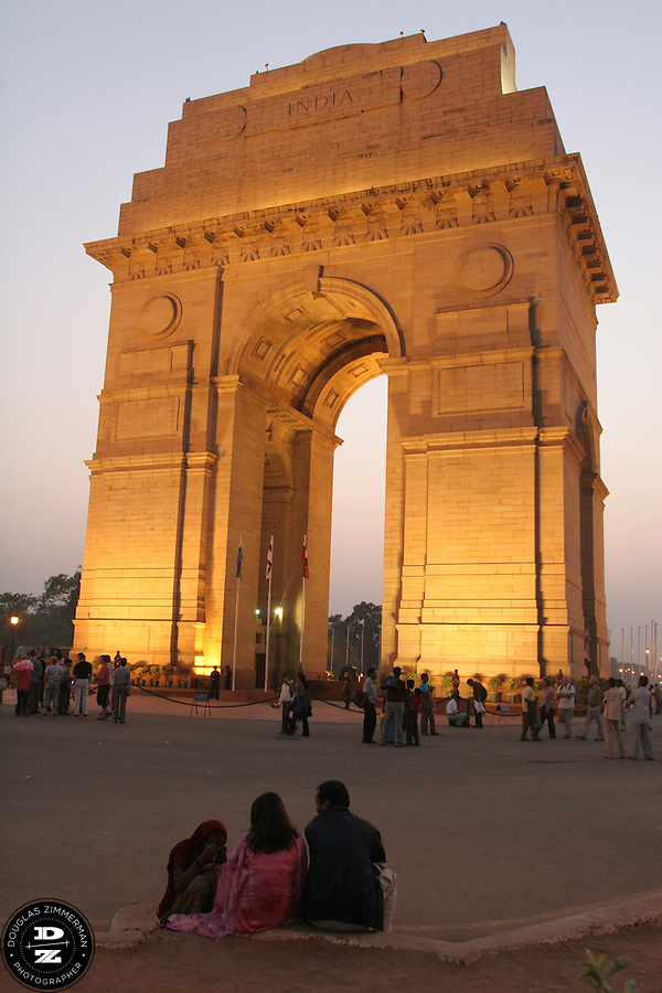 Visitors gather around India Gate in Delhi, India shortly after sunset.  The 42 meter high memorial arch bears the names of 90,000 Indian army soldiers who died in World War I.      Photograph by Douglas ZImmerman