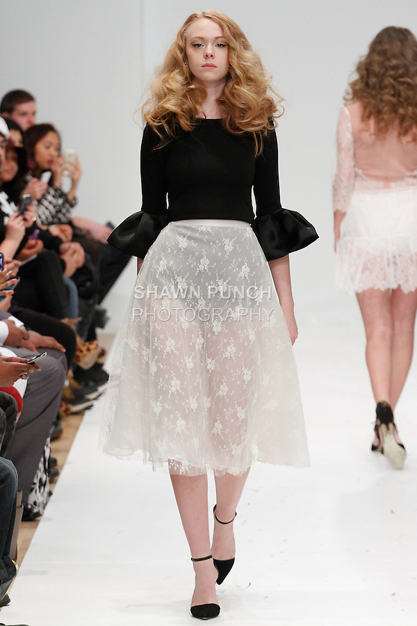 Model walks runway in an outfit from the Di by Diana Vazquez Fall 2014 collection, for Designer's Premier Fall Winter 2014, during New York Fashion Week Fall 2014, February 9, 2014.