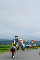 Horseback participants returning home in the eventing after events in the Somanomaoi Festival, Minami-soma City, Fukushima Prefecture, Japan, July 28, 2013. During the four-day-long Somanomaoi Festival members of old samurai families ride horseback through the town in traditional armour.  They also take conduct ceremonies at local shrines, take part in horse races, and compete on horseback to catch a flag launched into the air by fireworks.
