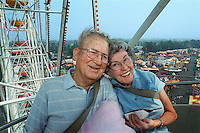 Sid Woolever, 78, and his wife, Lee, 77, who are at their 52nd consecutive California State Fair, ride the Ferris wheel on August 25, 1999. The couple to the fair on a date in 1948 and were married later that year.
