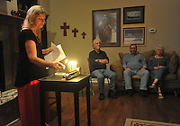 NWA Media/Michael Woods --09/11/2014-- w @NWAMICHAELW... Dian Williams lights an interfaith candle as she leads a monthly Taize service for peace in her Fayetteville home. The Taize consists of an hour of music, meditation, prayer, chants, candle lighting and inspirational readings.
