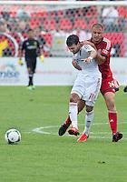 29 June 2013: Toronto FC forward Danny Koevermans #14 battles with Real Salt Lake midfielder Javier Morales #11 during an MLS game between Real Salt Lake and Toronto FC at BMO Field in Toronto, Ontario Canada.<br /> Real Salt Lake won 1-0.
