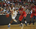 Florida's Michael Frazier II (20) vs. Ole Miss' LaDarius White (10) in the SEC championship game at Bridgestone Arena in Nashville, Tenn. on Sunday, March 17, 2013.